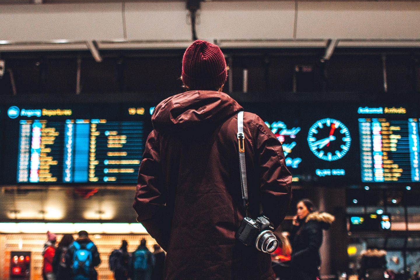 Man looking at departures list
